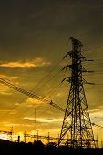 High Voltage Post High-voltage Tower / Silhouette Of High Voltage Post On Sunset Orange Yellow Sky B poster
