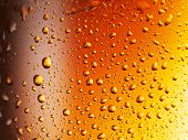 Condensated drops of misted glass of beer. Close up shot . poster
