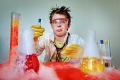 Crazy Young Scientist Performing Experiments In Lab poster
