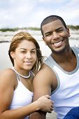 picture of married couple  - Interracial couple looking into camera smiling - JPG