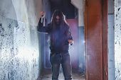 Serial Killer Maniac With Knife In Dark Abandoned Building. Maniac Thriller Concept. poster