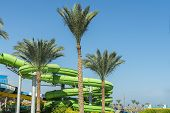 Colorful Slides And Pool In Aqua Park. Place To Have A Rest And Family Fun. Long, Green Waterslide I poster