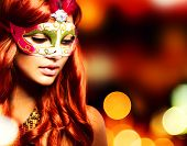 Party.Masquerade. Beautiful Girl in a Carnival mask over Holiday Blinking Background.