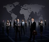 foto of crew cut  - business team formed of young businessmen standing over a dark background - JPG