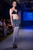 CHENNAI - JULY 21: A model walks on the ramp showcasing designer chaitanya Rao work during the Chenn