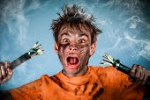 stock photo of teen smoking  - Boy has a electric shock - JPG