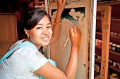 KATHMANDU, NEPAL - MAY 19: Nepalese woman drawing traditional painting on May 19, 2013 in Kathmandu
