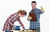 image of workbench  - Couple working at a workbench - JPG