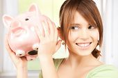 stock photo of piggy  - picture of lovely girl with big piggy bank - JPG