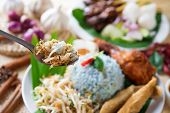 Nasi kerabu, famous Malaysian Malay rice dish. Traditional east coast blue rice. Popular in states s