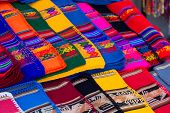 picture of alpaca  - Colorful Fabric at market in Peru South America - JPG