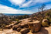 stock photo of granite  - A View of the Amazing Granite Stone Slabs, Scenic Vista, and Boulders of Legendary Enchanted Rock, a Small Dome Mountain, Texas.  Western landscape.