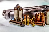 stock photo of guns  - Guns and Ammunition for Fun or Self Defense - JPG