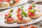 stock photo of canapes  - Mediterranean style canape with feta cheese and tomato - JPG