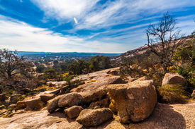 picture of granite dome  - A View of the Amazing Granite Stone Slabs, Scenic Vista, and Boulders of Legendary Enchanted Rock, a Small Dome Mountain, Texas.  Western landscape.