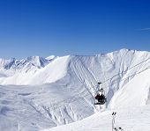stock photo of ropeway  - Skiers on ropeway at ski resort Gudauri at nice day - JPG