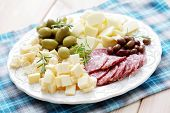 stock photo of cheese platter  - cheese and olives on a plate as a snack  - JPG