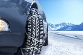 image of mountain chain  - Car with mounted snow chains in wintry environment - JPG