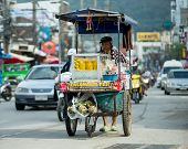 PHUKET, THAILAND JANUARY 1: Street vendors goes to work on January 1, 2014 in Phuket, Thailand. Acco
