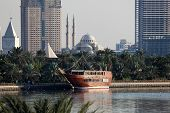 stock photo of emirates  - Traditional wooden dhow at the Sharjah Creek - JPG