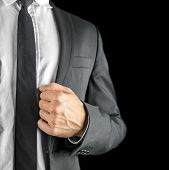 pic of lapel  - Conceptual image of a stylish businessman executive or professional holding the lapel of his jacket conceptual of success confidence expertise and authority - JPG