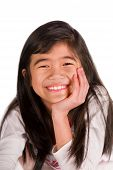 stock photo of biracial  - Biracial Asian girl chin on hand smiling - JPG