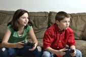 Sister And Brother Playing A Video Game poster