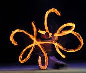 stock photo of poi  - Artist juggling with two burning poi - JPG