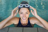 pic of swimming  - Fit swimmer smiling up at camera in the swimming pool at the leisure center - JPG