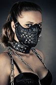 image of sadistic  - portrait of a brutal woman with mask spikes - JPG