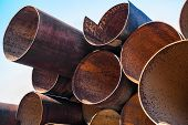 image of orifice  - Lots of rusty metal pipes put together - JPG