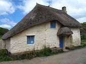 stock photo of quaint  - Quaint thatched cottage photographed at Hope Cove in Devon