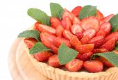 stock photo of tarts  - Strawberry tart with green mint leaves isolated on white - JPG