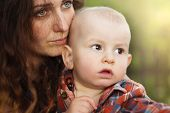 picture of crying boy  - Portrait of a crying little boy who is being held by her mother - JPG
