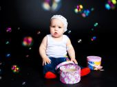 Baby With Presents And Soap Bubbles