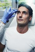 stock photo of medical injection  - Attractive man giving facial injections in aesthetic clinic  - JPG