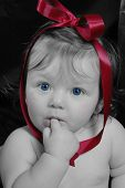 stock photo of blue eyes  - *** Note, slight graininess, best at smaller sizes. This baby girl is sucking on the tip of her finger.  This photograph is Black & White with original color enhancments. - JPG