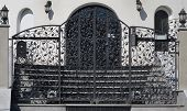 foto of metal grate  - wonderful modern metal gate with leaf as decoration
