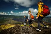 image of descending  - Group of hikers descending on friable ground in the caldera of volcano of Batur - JPG
