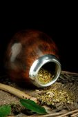 stock photo of calabash  - Calabash and bombilla with yerba mate isolated on black - JPG