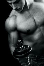 stock photo of lifting weight  - Bodybuilder in action  - JPG