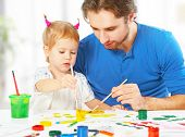 pic of father child  - happy family father and child baby daughter together draw paints - JPG