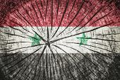 picture of civil war flags  - Flag of Syria on cracked wooden texture - JPG