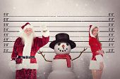 stock photo of mug shot  - Jolly Santa waving at camera against mug shot background - JPG