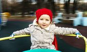pic of merry-go-round  - Cute little girl rounding on merry - JPG