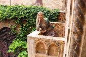 stock photo of juliet  - Attractive girl is standing on the balcony of Juliet in Verona Italy  - JPG