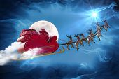 picture of bye  - Santa Claus riding a sleigh led by reindeers following the star  - JPG