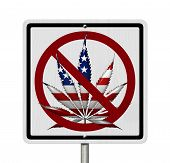 stock photo of marijuana leaf  - Driving Under the Influence of Marijuana A road highway sign with a marijuana leaf in USA flag colors isolated on white - JPG