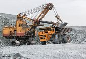 picture of asbestos  - The process of loading excavator asbestos in rock dump - JPG