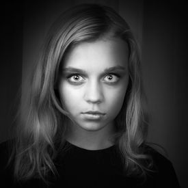 image of hypnotic  - Serious blond Caucasian girl with mysterious hypnotic look - JPG